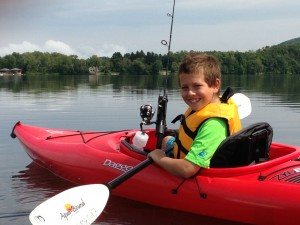 My son kayaking & fishing on Richmond Pond